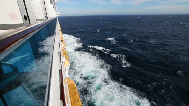 Cruise ship wake and blue sea from external side cabin
