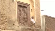 Crumbling walls and poor infrastructure in the remote village of Gah in Pakistan betray the humble origins of its most famous former inhabitant...