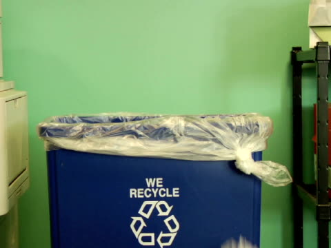 MS, Crumpled papers being thrown into recycle bin