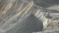 Crushed iron ore dumping off a belt.