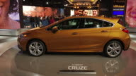 WS Cruze revolving on turntable / PAN LEFT WS Cruze front end revolving on turntable / CU RS grille emblem ZO MS front end / WS HA looking down on...