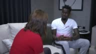 Crystal Palace player Pape Souare nearly ready to reutrn after horrific car crash Souare interview SOT Various of Souare looking out from the picture...
