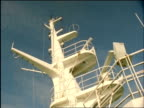 Cu looking up at radar spinning on ships mast, United Kingdom