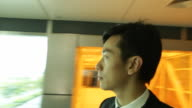 c/u Rotating around businessmans head 360 degrees, building interior background