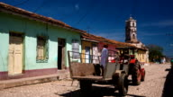 Cuba: Travel : Trinidad street scene with colourful houses and Santa Anna church