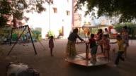 LS of Cuban children playing in park / Havana playground