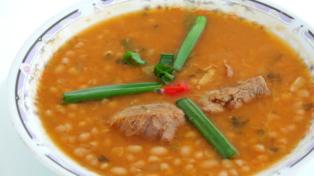 Cuban cuisine traditional food dish: soup of white kidney beans with pork meat