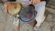 CU Cuban musician playing bongos / Havana, Cuba