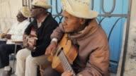 MS PAN ZO Cuban musicians playing music on corner of street in Cuba / Havana, Cuba