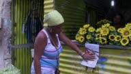 Cubans in Havana donate money food and clothing to the poor ahead of a visit from Pope Francis