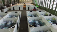 Cubicles furnished with bunk beds stand ready to accommodate refugees and asylum applicants in Hangar 6 of former Tempelhof Airport on February 11...