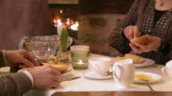 CUCouple at breakfast table / Saarburg, Rhineland-Palatinate, Germany