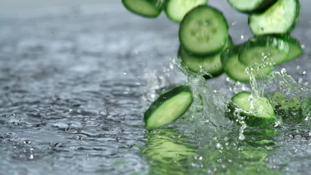 cucumbers splashing and bouncing on water