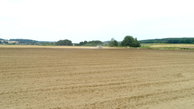 Cultivating field - Agriculture background.