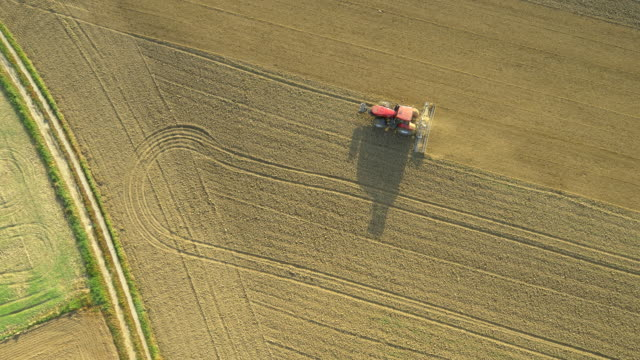 AERIAL Cultivating Fields With The Tractor