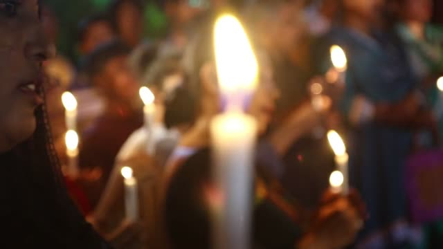 Cultural activists teachers and people from all walks of life attend a candlelight vigil to pay homage to the people who have been killed in a...