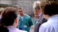 Prince Charles visits West Cumberland Hospital More of Prince Charles talking to nurses and surgeons outside hospital/ Prince Charles meeting and...