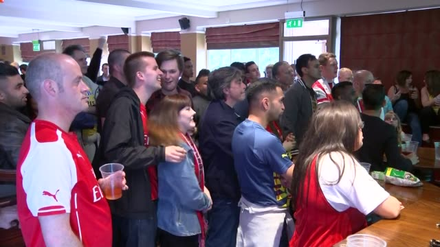 Arsenal fans watch match in pub ENGLAND London INT Various of Arsenal supporters watching the FA Cup Final in a pub and celebrating
