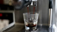 Cup of Coffee Being Poured from Professional Espresso Machine