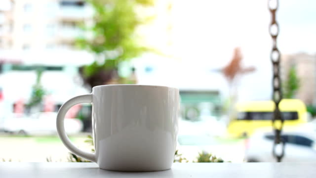 Cup of coffee on a marble cafe table, outdoors