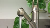 Cup Of Water Being Filled From Faucet on October 08 2013 in Chicago Illinois