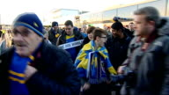 second round matches AFC Wimbledon fans cheering and waving flags as boarding coaches after match