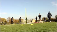 preview AFC Wimbledon training session ENGLAND EXT General views AFC Wimbledon football squad in training doing running and dribbling exercises /...