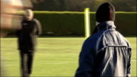 preview AFC Wimbledon training session More shots AFC Wimbledon footballers training coach shouting instructions SOT / Player's legs with 'Wimbledon'...