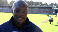 Third round matches Kingston upon Thames Kingsmeadow EXT Adebayo Akinfenwa interview SOT Cup trophy Various shots sun shining over football pitch...