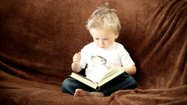Curious boy with magnifying glass