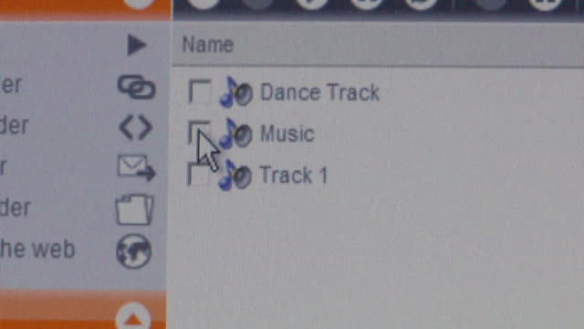 CU Cursor clicking on 'Music' checkbox on computer screen and downloading music/ Brooklyn, NY