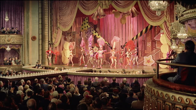 MS  Curtains open and burlesque / vaudeville troupe performing on stage  / New York, New York, United States