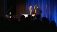 SPEECH Curtis '50 Cent' Jackson says that growing up in Jamaica Queens he saw poverty presents award to Tom Colicchio and Lori Silverbush Colicchio...