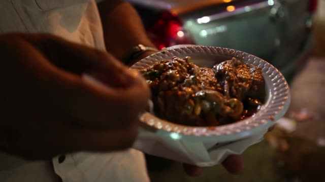 Customer eating Hyderabadi Haleem at popular Cafe 555 during ramadan in Hyderabad,India