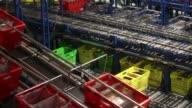 Customer order crates travel along conveyor belts at the Ocado Group Plc distribution centre in Dordon UK on Friday Dec 16 2016