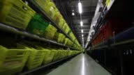 Customer order crates travel along conveyor belts at the Ocado Group Plc distribution centre in Dordon UK on Friday Dec 16 Employee pick customers...