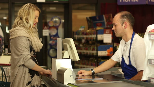 Customer paying for shopping at supermarket