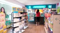 A customer pays for purchases at a cashier's counter in a Watsons store operated by AS Watson Group a unit of CK Hutchison Holdings Ltd in the...