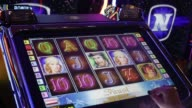 A customer plays on an electronic slot gambling machine inside an Admiral Casinos Entertainment AG casino operated by Novomatic AG in Wiener Neudorf...