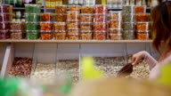 Customer purchases seeds in grocery
