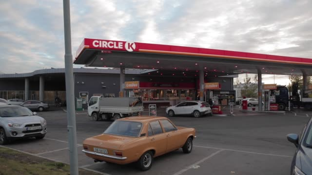 A customer refuels his vehicle at the fuel pumps at a Circle K gas station operated by Alimentation CoucheTard Inc in the Oekern district of Oslo...