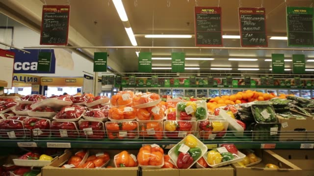 A customer selects a bag of lemons from the fruit section inside a supermarket in Moscow Russia on Friday Aug 8 A customer selects two cartons of...