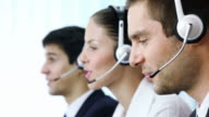 Customer support operators working at office