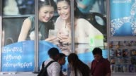 A customer uses an Asustek Computer Inc Zenfone Go T500 smartphone at a Telenor Myanmar store in Yangon Myanmar on Friday March 10 A customer uses an...
