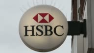 A customer uses an automated teller machine outside an HSBC Holdings Plc bank branch in Chadwell Heath UK on Friday May 2 Signage sits on wall of...