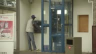 A customer withdraws money from an Ecobank Pan African bank automated teller machine in N'Djamena Chad on Tuesday Aug 15 A customer fills his...