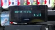 Customers can pay using their fingertips at store in London ENGLAND London INT Various of man to counter in supermarket to buy a bottle of water and...