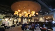 Customers drink coffee in the Luigi Lavazza SpA cafe inside the new Eataly food store operated by Eataly Net Srl at the Kievsky shopping mall in...