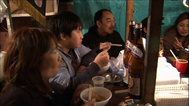 Customer's eat at a food stall at Ohtori Shrine.  Tori-no-Ichi