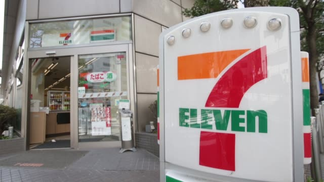 Customers enter and exit a 7Eleven convenience store operated by Seven I Holdings Co in Tokyo 7Eleven convenience stores in Tokyo on April 04 2013 in...